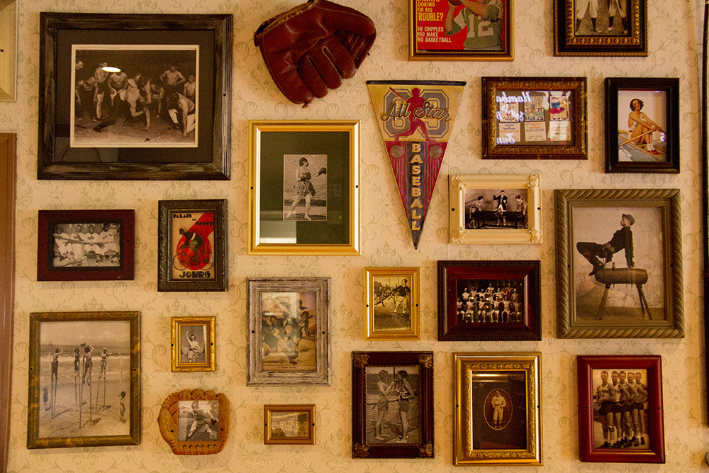 A wall of found vintage sports images in varied frames at Hamburger Mary's on Humboldt and 17th. (Kevin J. Beaty/Denverite)  hamburger marys; food; restaurant; denver; colorado; kevinjbeaty; denverite