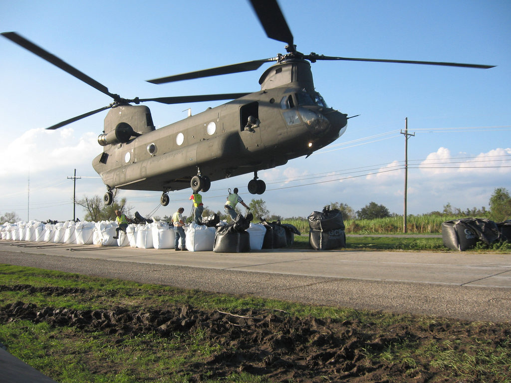 Sandbags weighing 4,000 pounds each are hooked to an Army National Guard CH-47 Chinook helicopter to repair a broken levee southeast of New Orleans, La., Sept.6, 2008. The levee was damaged by Hurricane Gustav. (Official U.S. Army photo by Sgt. Brian Cooper, 2nd Battalion, 135th Aviation Regiment, Colorado Army National Guard)