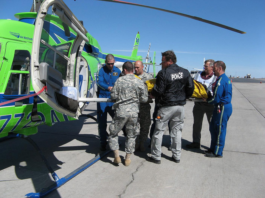 """DENVER---The """"Mountain Move"""" exercise was truly a joint venture as representatives from several agencies worked to load a patient onto an AirLife of Denver medical evacuation helicopter. Patients were transported from the reception area by ground and air ambulances to local hospitals. Photo Credit: Roger G. Meyer, Evans Army Community Hospital Public"""