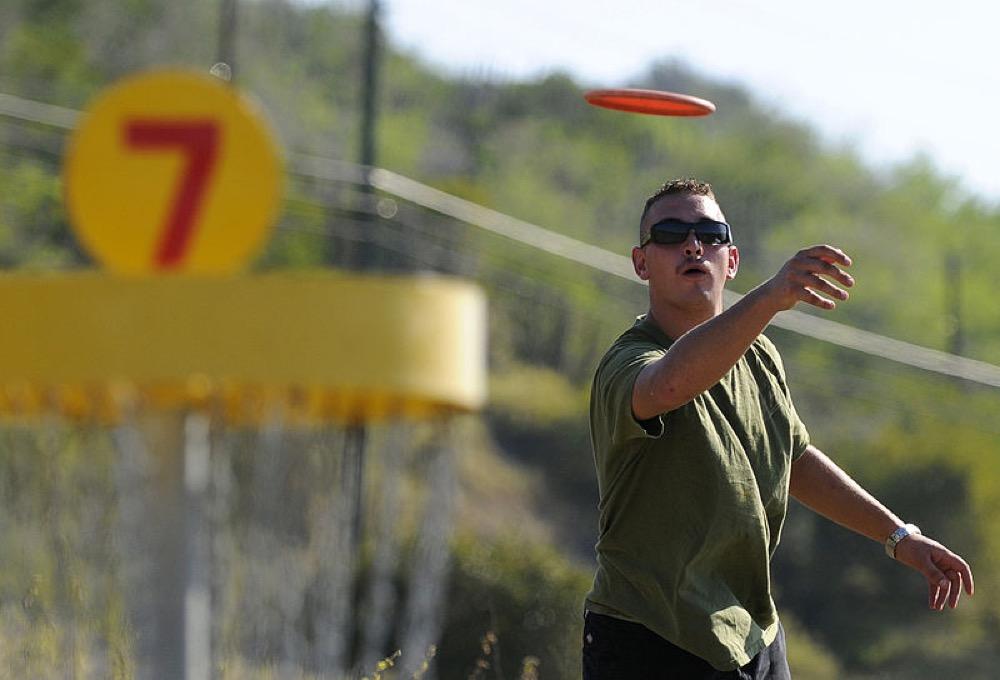 A man plays disc golf at Guantanamo Bay.