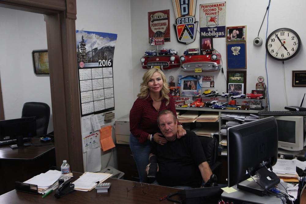 "David ""Red"" Widhalm and Jodina Widhalm at their business, Red's Anytime Bail Bonds, on Delaware Street. (Andrew Kenney/Denverite)"