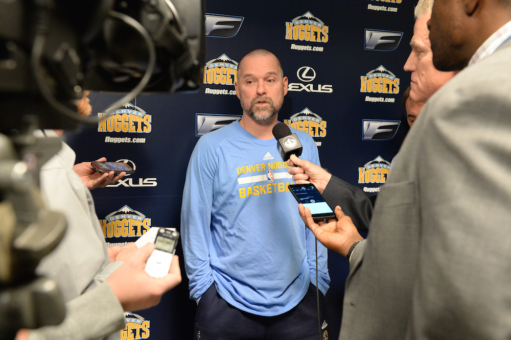 DENVER, CO - DECEMBER 8: Michael Malone of the Denver Nuggets talks during an interview before the game against the Orlando Magic on December 8, 2015 at the Pepsi Center in Denver, Colorado. NOTE TO USER: User expressly acknowledges and agrees that, by downloading and/or using this Photograph, user is consenting to the terms and conditions of the Getty Images License Agreement. Mandatory Copyright Notice: Copyright 2015 NBAE (Photo by Garrett Ellwood/NBAE via Getty Images)