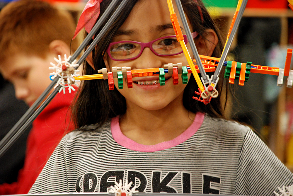 A student at Indian Peaks Elementary School works on a project in class. (Nicholas Garcia/Chalkbeat)