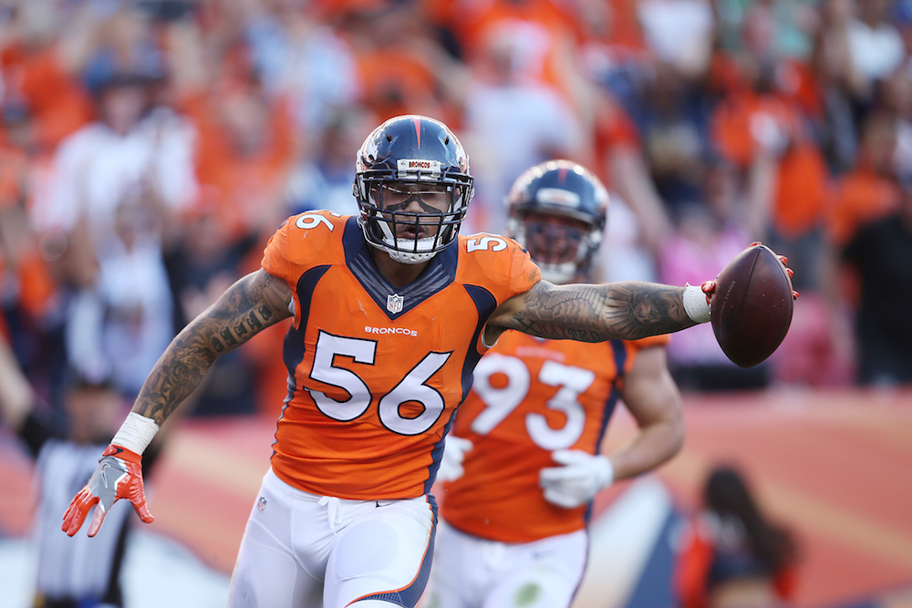 Denver Broncos linebacker Shane Ray (56) reacts after scoring a touchdown after a strip sack by Von Miller during fourth quarter action against the Indianapolis Colts during the game at Sports Authority Field at Mile High in Denver, CO, September 18, 2016. Photo by Gabriel Christus