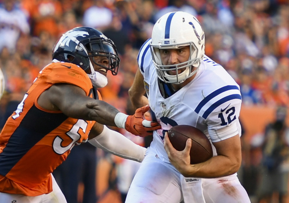 Denver Broncos linebacker Brandon Marshall (54) pressures Indianapolis Colts quarterback Andrew Luck (12) during fourth quarter  action in the NFL game at Sports Authority Field in Denver, Colo. September 18, 2016.
