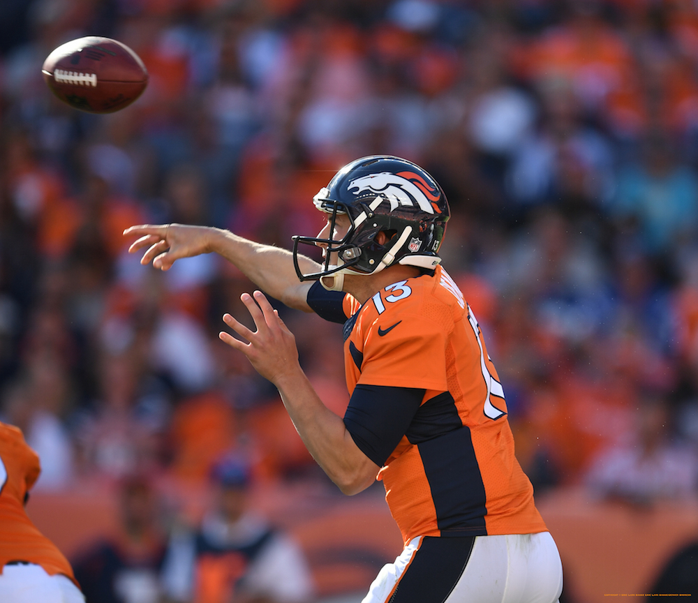 Denver Broncos quarterback Trevor Siemian (13) passes during third quarter  action against the Indianapolis Colts in the NFL game at Sports Authority Field in Denver, Colo. September 18, 2016.