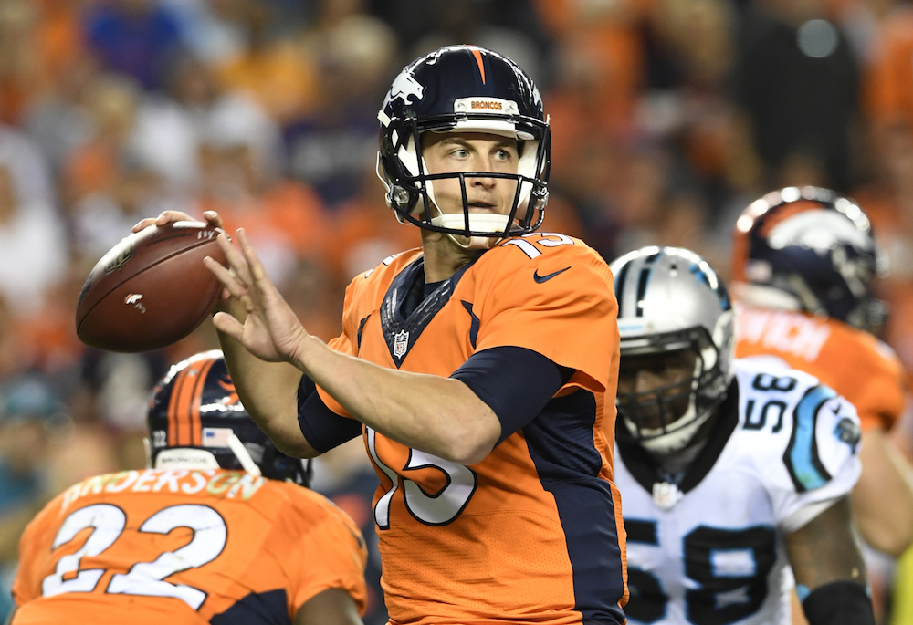 Denver Broncos quarterback Trevor Siemian (13) looks to throw to an open receiver during the 2nd half of  action against the Carolina Panthers in the NFL game at  Sports Authority Field in Denver, Colo. September 8, 2016.