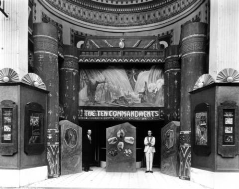 "The Victory Theater with a display of ""Egyptian"" columns and Moses parting the Red Sea for Cecil B. DeMille's ""The Ten Commandments"" in 1923. The theater was known for elaborate promotional displays."