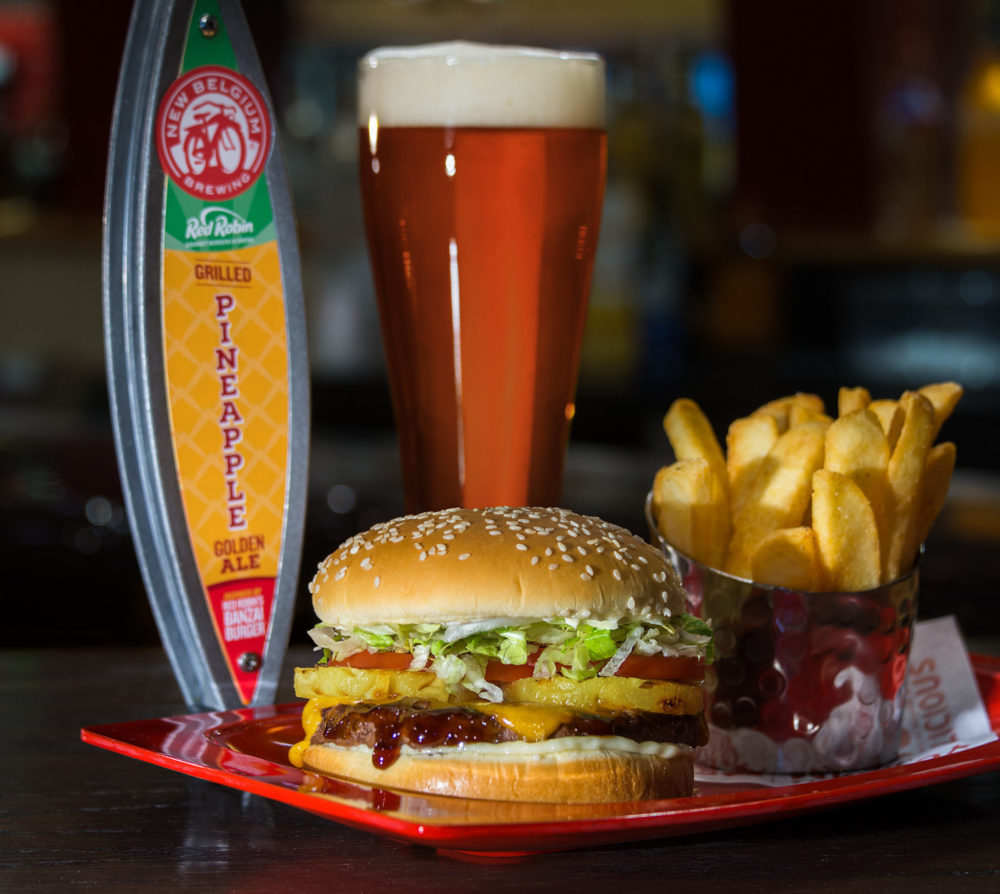 New Belgium's Grilled Pineapple Golden Ale paired with Red Robin's Banzai Burger. (Courtesy of Red Robin)