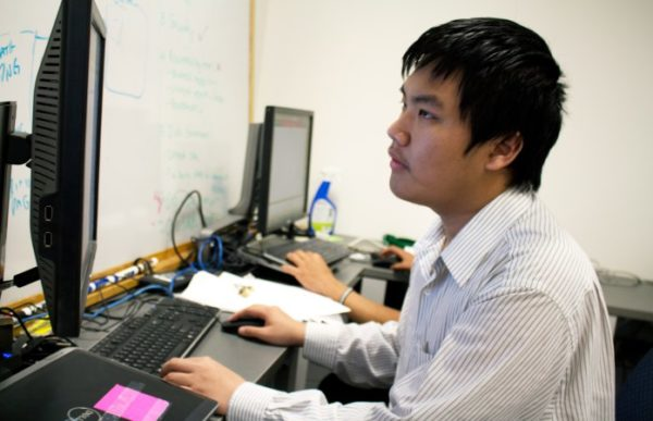 Denver student Quang Nguyen works at an internship this past summer. (Photo by Denver Public Schools)
