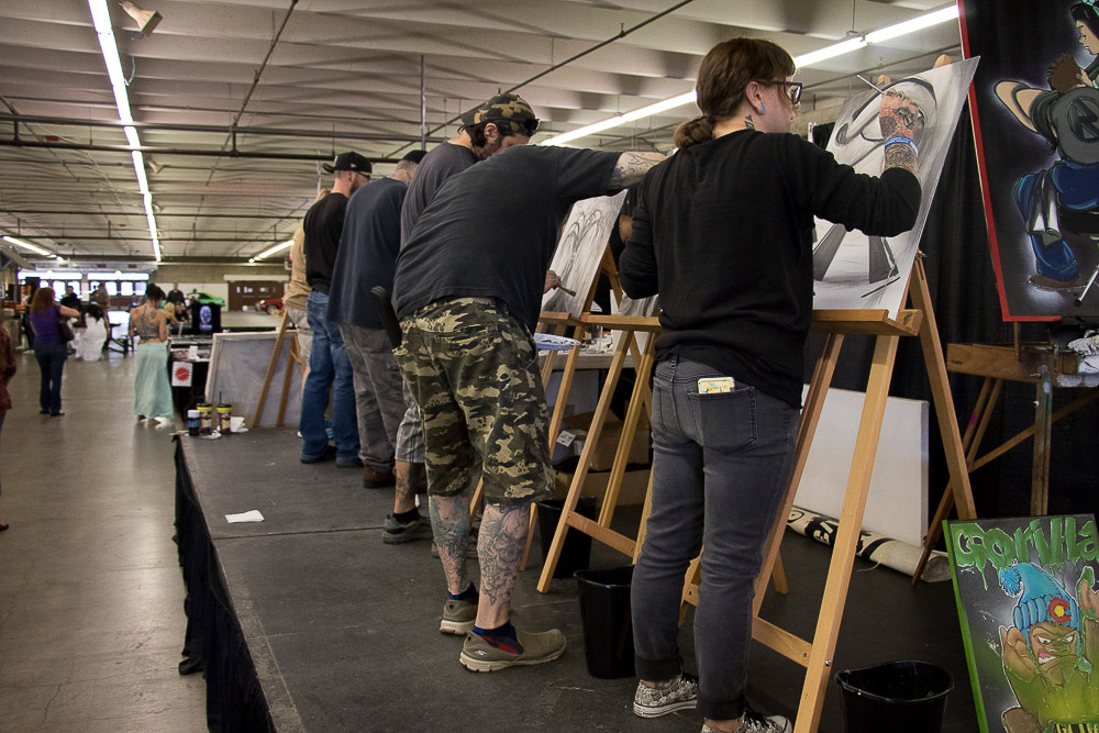 Ink Fusion paintings by Colorado Tattoo Convention artists are raffled off. All proceeds go to charity. (Chloe Aiello/Denverite)