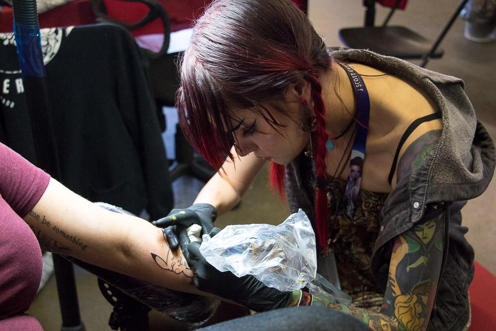 Violetta from Unity Tattoo of Wheat Ridge at the Colorado Tattoo Convention. (Chloe Aiello/Denverite)