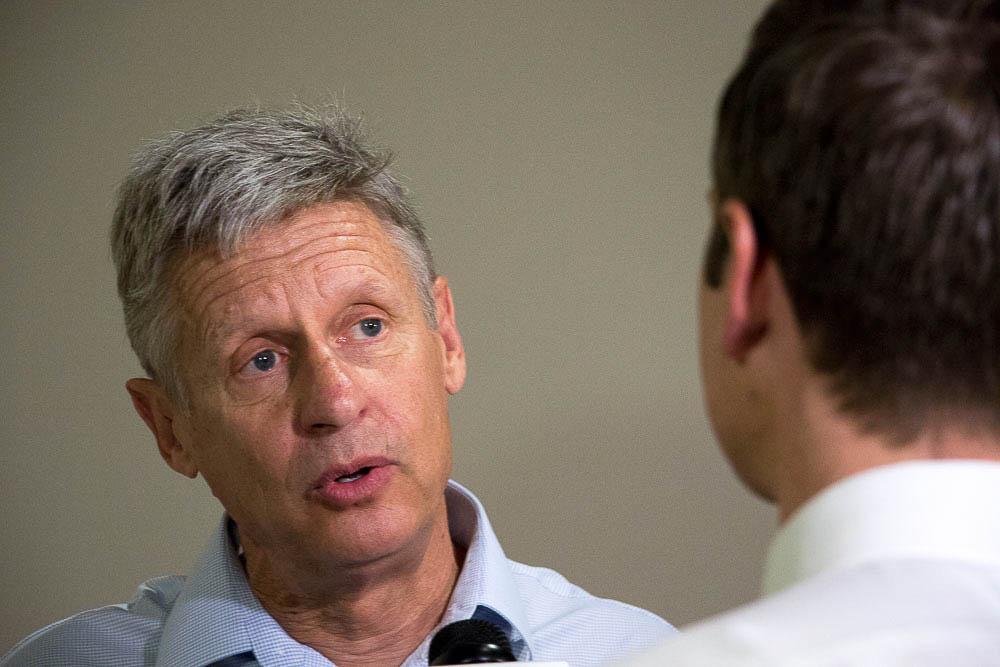 Gary Johnson speaks to a reporter at CU South Denver. (Chloe Aiello/Denverite)