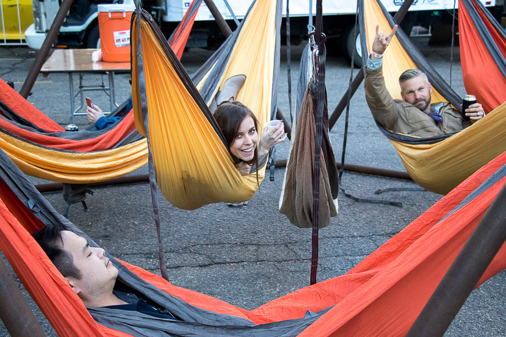 A couple of beer-loving folks hang in hammocks at Beerliner and Chill. (Chloe Aiello/Denverite)