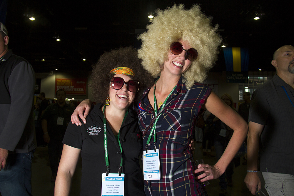"Oskar Blues Brewery reps Kelsy Colvin (right) and Danielle, ""no last name, like Madonna"" at the Great American Beer Fest, Oct. 6, 2016. (Kevin J. Beaty/Denverite)  great american beer fest; gabf; denver; colorado; food; nightlife; kevinjbeaty; denverite; denver; colorado;"