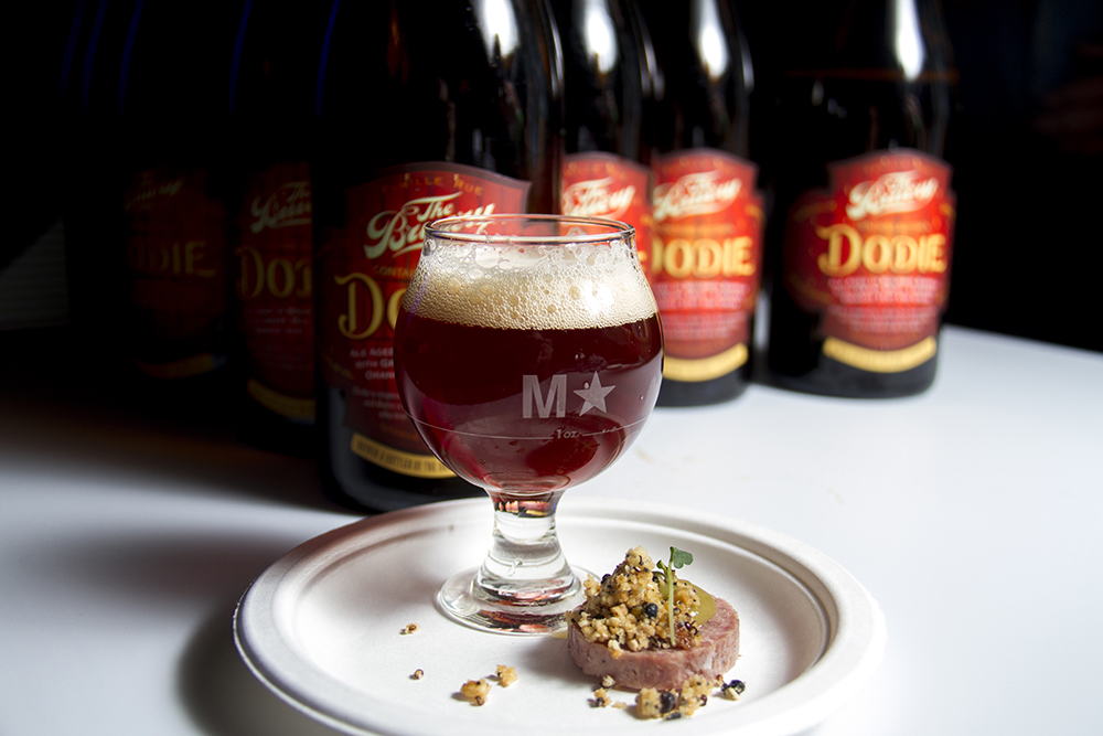 """Denver-based Mercantile serves up a duck confit terrine drizzled with a golden raisin caper emulsion and topped with an oat, barley and rice """"brewer's cereal"""" and paired with The Dodie, a beery recreation of a Manhattan cocktail loaded with orange zest, cherry juice and 30+ spices from Orange County's The Bruery. (Kevin J. Beaty/Denverite)  food; gabf; great american beer fest; beer; kevinjbeaty; denverite; denver; colorado;"""