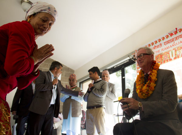 Aurora mayor Steve Hogan is honored by a priest. Hindu Durga Puja celebration held in Aurora's Lowry Park pavilion by the local community of Bhutanese/Nepali refugees. (Kevin J. Beaty/Denverite)  bhutanese refugees; nepali; hinduism; religion; puja; kevinjbeaty; denver; denverite; colorado;