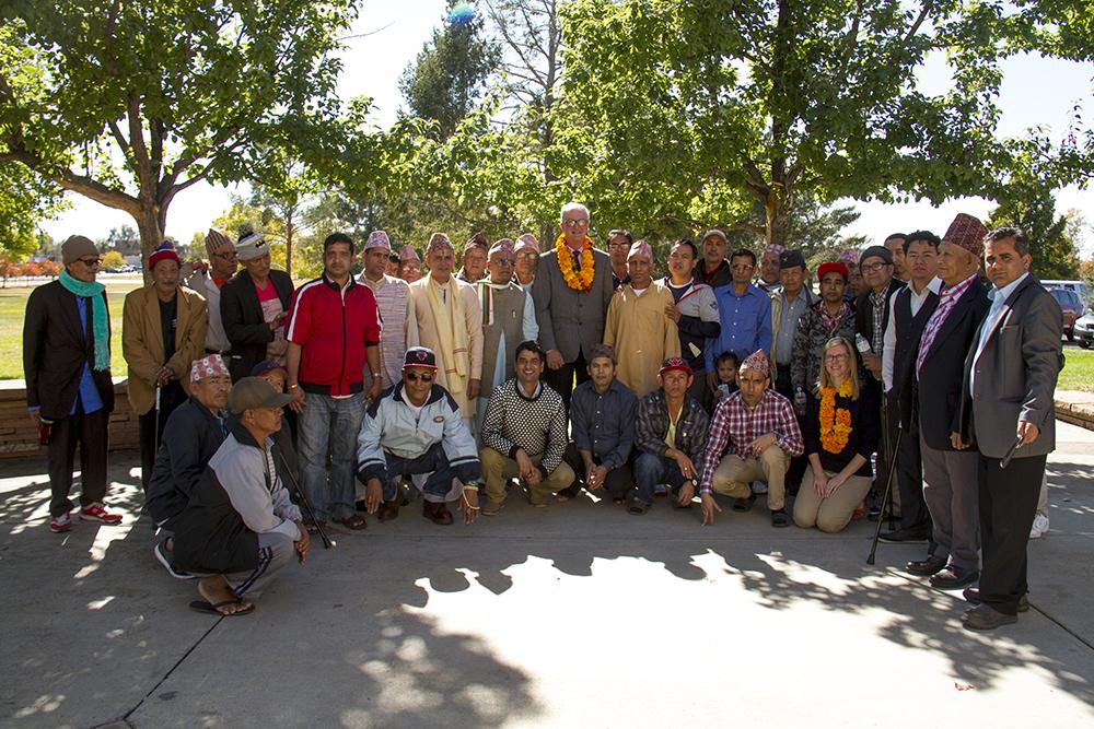 Aurora mayor Steve Hogan is honored by a priest. Hindu Durga Puja celebration held in Aurora's Lowry Park pavilion by the local community of Bhutanese/Nepali refugees. (Kevin J. Beaty/Denverite)  bhutanese refugees; nepali; hinduism; religion; puja; kevinjbeaty; denver; denverite; colorado;