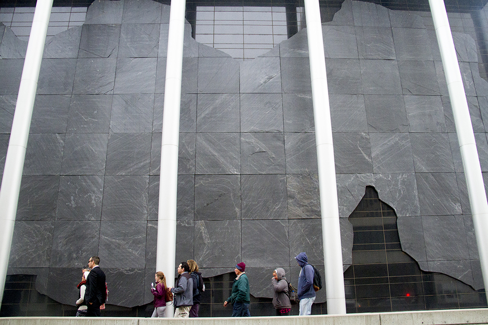 Supporters walk around to enter the courthouse. Oct. 12, 2016. (Kevin J. Beaty/Denverite)  homeless sweeps; jason flores-williams; court; lawsuit; denver; colorado; denverite; kevinjbeaty; camping ban; right to rest;