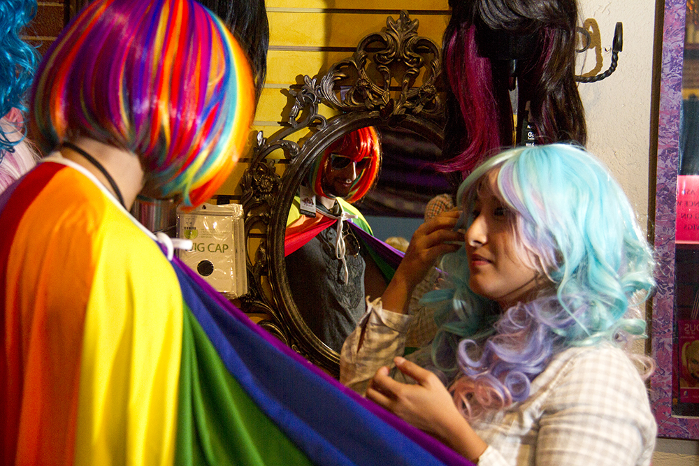 Yousef Bizri (left) and Clara Doan try on wigs at the Wizard's Chest. (Kevin J. Beaty/Denverite)  costume; halloween; wizards chest; denver; denverite; colorado; kevinjbeaty;
