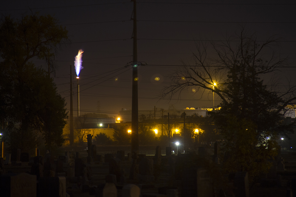 The Suncor refinery, seen from Riverside Cemetery. (Kevin J. Beaty/Denverite)  riverside cemetery; history; kevinjbeaty; denverite; denver; colorado; suncor refinery; energy;