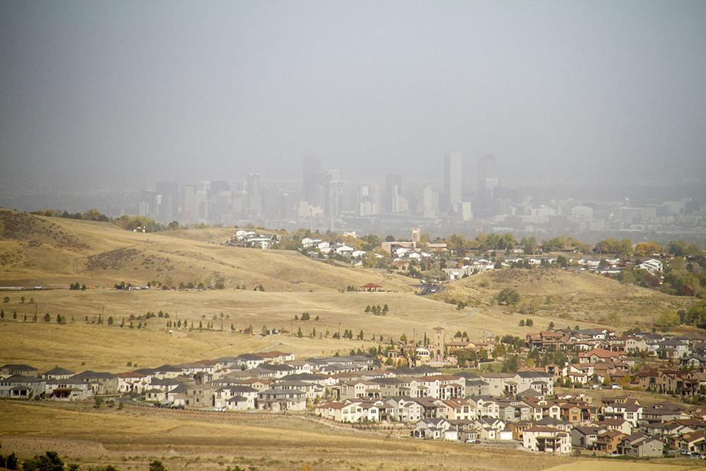 A hazy city, as seen from Red Rocks. (Kevin J. Beaty/Denverite)  cowx; weather; skyline; cityscape; red rocks; morrison; kevinjbeaty; denver; denverite; colorado;