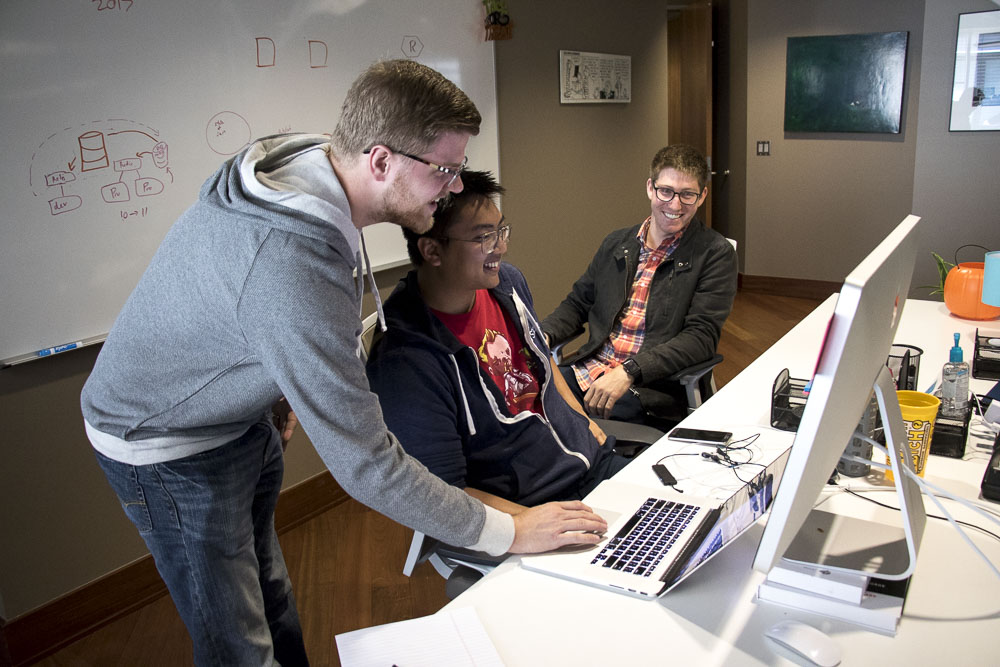 Nate, Aaron and Alex working at JStar's Cherry Creek office. (Chloe Aiello/Denverite)
