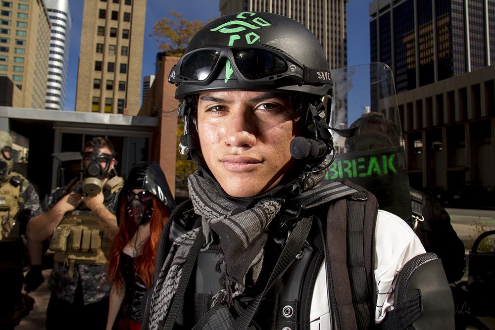 Daniel Clauss dressed as an anti-zombie agent at the Denver Zombie Crawl. Oct. 22, 2016. (Kevin J. Beaty/Denverite)  zombie crawl; halloween; cosplay; 16th street mall; sixteenth street; kevinjbeaty; denver; colorado; denverite; cbd;