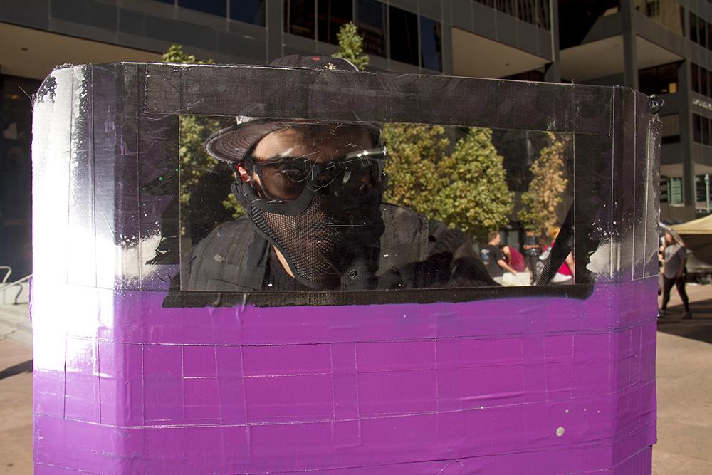 3OZ Outbreak Response Team member Zach Carrosco. Denver Zombie Crawl. Oct. 22, 2016. (Kevin J. Beaty/Denverite)  zombie crawl; halloween; cosplay; 16th street mall; sixteenth street; kevinjbeaty; denver; colorado; denverite; cbd;