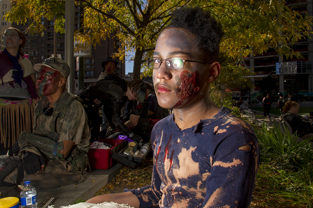 Zombie Alex Hagan poses for a portrait. Denver Zombie Crawl. Oct. 22, 2016. (Kevin J. Beaty/Denverite)  zombie crawl; halloween; cosplay; 16th street mall; sixteenth street; kevinjbeaty; denver; colorado; denverite; cbd;