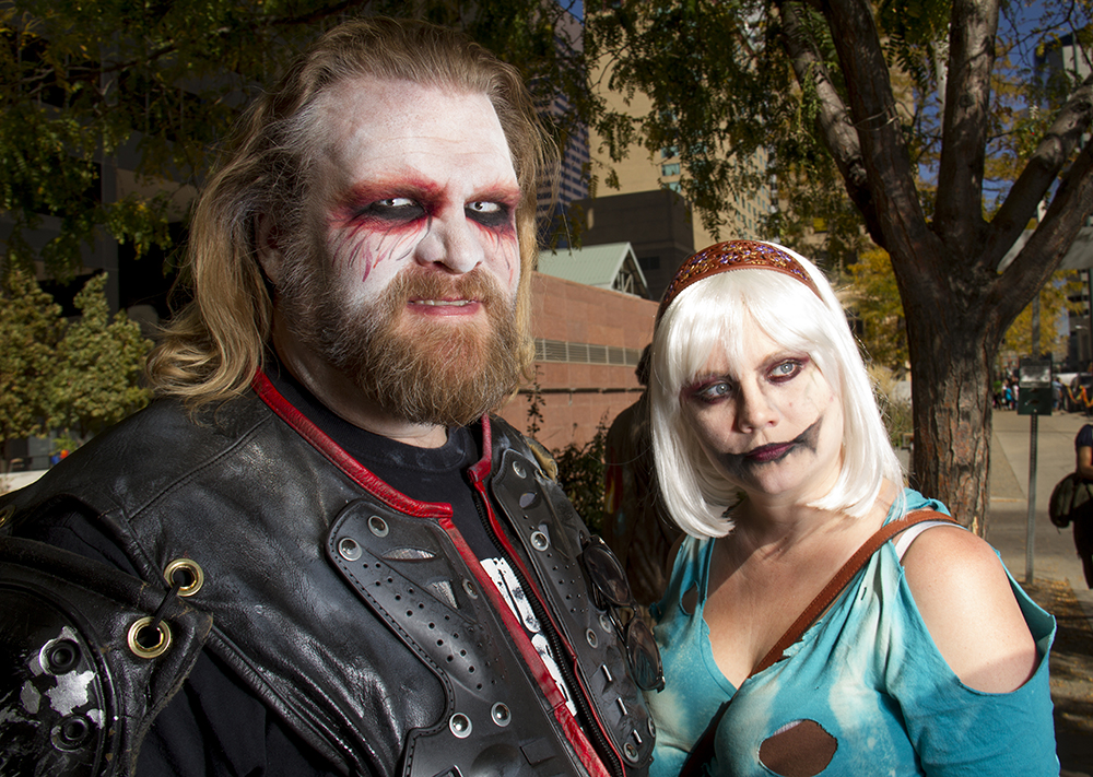 Ray Bruels and Juliette Mayer, two of the braiiiins behind Dystopia Rising in Conifer, your local post-apocolyptic live-action-role-playing group. Denver Zombie Crawl. Oct. 22, 2016. (Kevin J. Beaty/Denverite)  zombie crawl; halloween; cosplay; 16th street mall; sixteenth street; kevinjbeaty; denver; colorado; denverite; cbd;