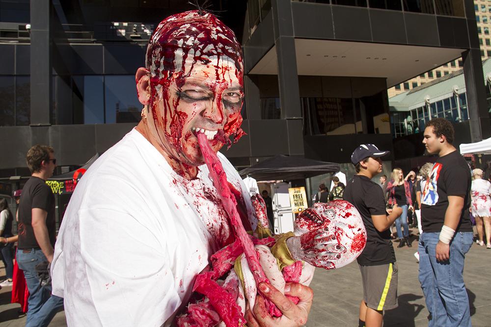 Daddy zombie Sotero Burciaga specializes in making morbid prosthetics.  Denver Zombie Crawl. Oct. 22, 2016. (Kevin J. Beaty/Denverite)  zombie crawl; halloween; cosplay; 16th street mall; sixteenth street; kevinjbeaty; denver; colorado; denverite; cbd;