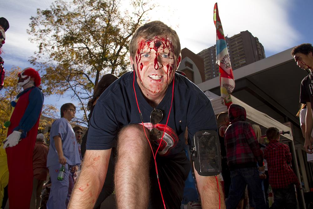"""Gaiinnnnzzz,"" yells Loren Hanson the running zombie. Denver Zombie Crawl. Oct. 22, 2016. (Kevin J. Beaty/Denverite)  zombie crawl; halloween; cosplay; 16th street mall; sixteenth street; kevinjbeaty; denver; colorado; denverite; cbd;"
