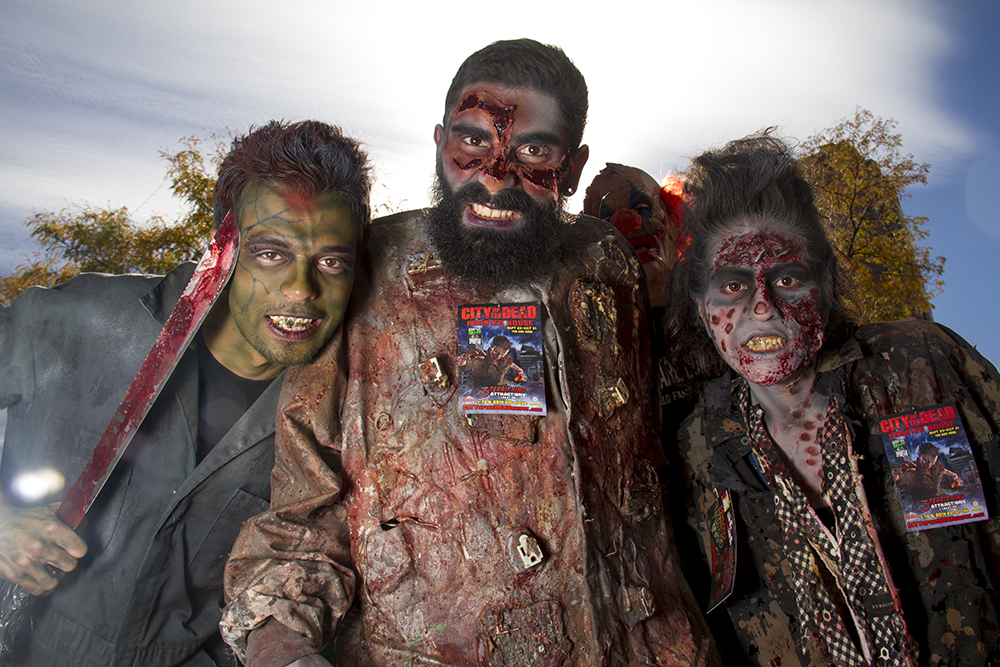 Jairo Heredia (left), Max Depriest and Toni Gloria representing the City of the Dead. Denver Zombie Crawl. Oct. 22, 2016. (Kevin J. Beaty/Denverite)  zombie crawl; halloween; cosplay; 16th street mall; sixteenth street; kevinjbeaty; denver; colorado; denverite; cbd;