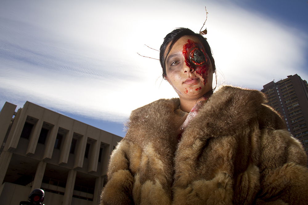 Brinkley Jaramillo, a fur coat-clad undead. Denver Zombie Crawl. Oct. 22, 2016. (Kevin J. Beaty/Denverite)  zombie crawl; halloween; cosplay; 16th street mall; sixteenth street; kevinjbeaty; denver; colorado; denverite; cbd;
