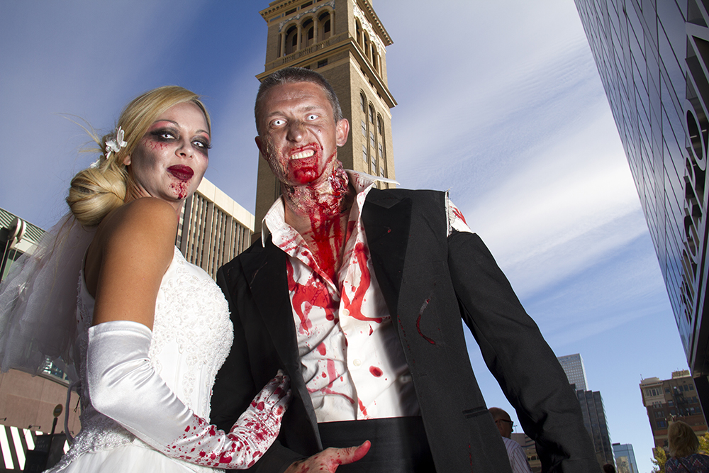 Matt Bolling and Crystal Gallimore, the undead newlyweds. Denver Zombie Crawl. Oct. 22, 2016. (Kevin J. Beaty/Denverite)  zombie crawl; halloween; cosplay; 16th street mall; sixteenth street; kevinjbeaty; denver; colorado; denverite; cbd;