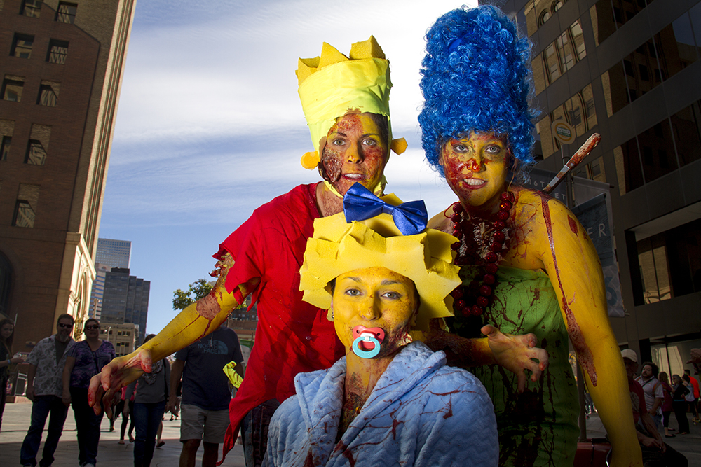 Treehouse of Horror-edition Simpsons family played here by Rachel Manzanares (left), Stephanie Ledoux and Sabrina Kennedy. Denver Zombie Crawl. Oct. 22, 2016. (Kevin J. Beaty/Denverite)