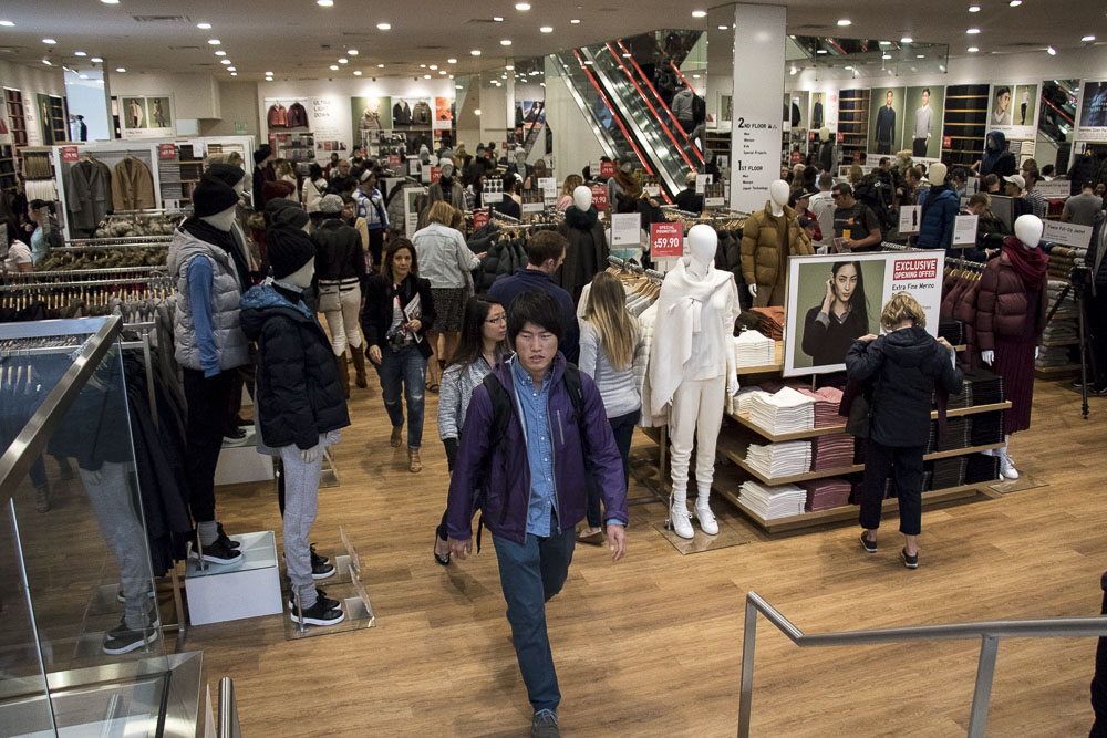 Customers shop during Uniqlo's grand opening on Denver's 16th Street mall (Chloe Aiello/Denverite)