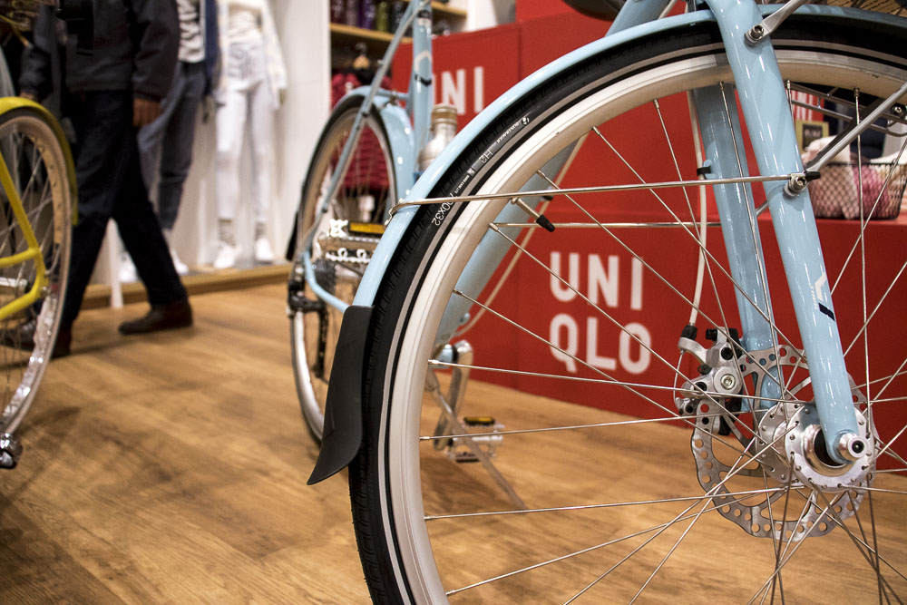 Bikes from Elevation Cycles occupy one corner of the Pavilions Uniqlo. (Chloe Aiello/Denverite)