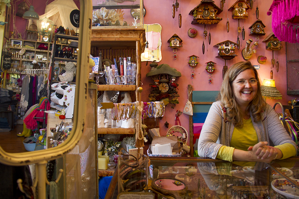 Talulah Jones owner Robin Lohre smiles from behind the counter. (Kevin J. Beaty/Denverite)