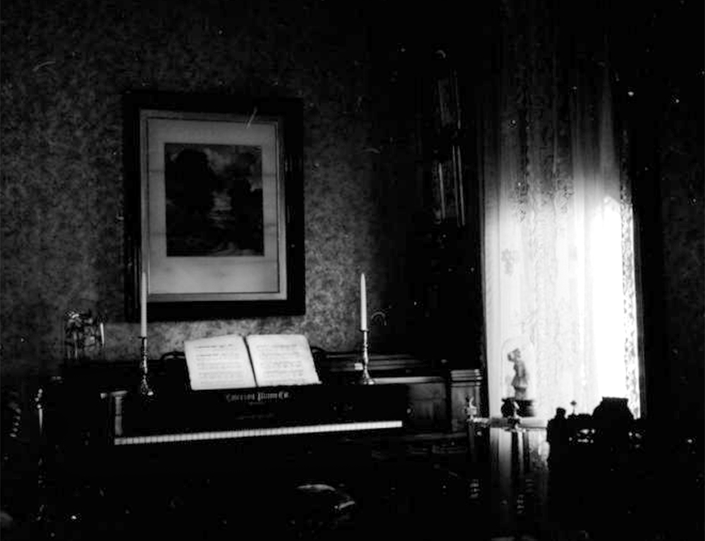 Interior view of a square grand piano at the Frank G. Bloom residence, in Trinidad, Colorado. Between 1960 and 1980. (Sandra Dallas/Denver Public Library/Western History Collection/X-1906)  history colorado; historic; denver public library; dpl; archive; archival; denverite