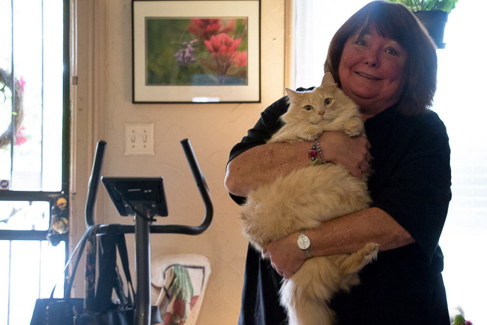 Kammie in her Denver home, where she lives with five indoor cats and four feral cats. (Chloe Aiello/Denverite)