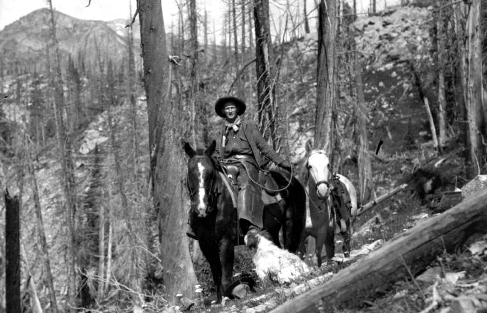 An unidentified man rides a horse along the Jasper Lake Trail west of Eldora in Boulder County, Colorado. Circa 1922. (Donald Kemp/Denver Public Library/Western History Collection/K-306)  five points; historic; denver public library; dpl; archive; archival; denverite
