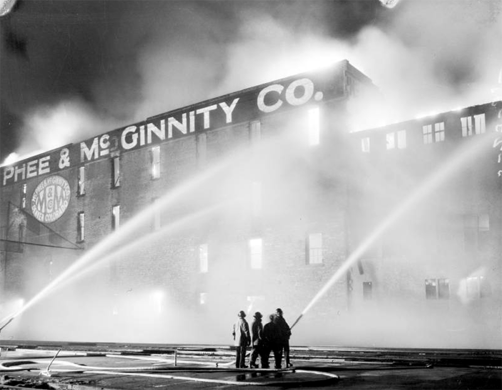 View of a fire and firemen in Denver, Colorado. May 23, 1935. (Harry Mellon Rhoads/Denver Public Library/Western History Collection/Rh-1319)  historic; denver public library; dpl; archive; archival; denverite
