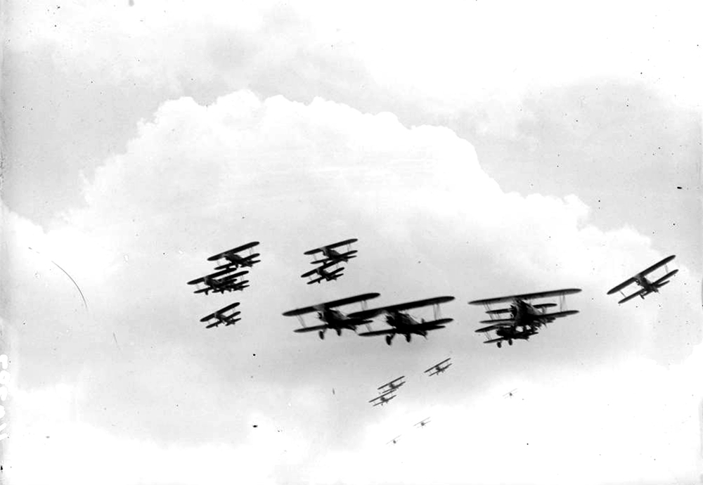 View of several Colorado Air National Guard biplanes in flight, possibly at Camp George West, Colorado. Between 1930 and 1935. (Harry Mellon Rhoads/Denver Public Library/Western History Collection/Rh-356)  historic; denver public library; dpl; archive; archival; denverite