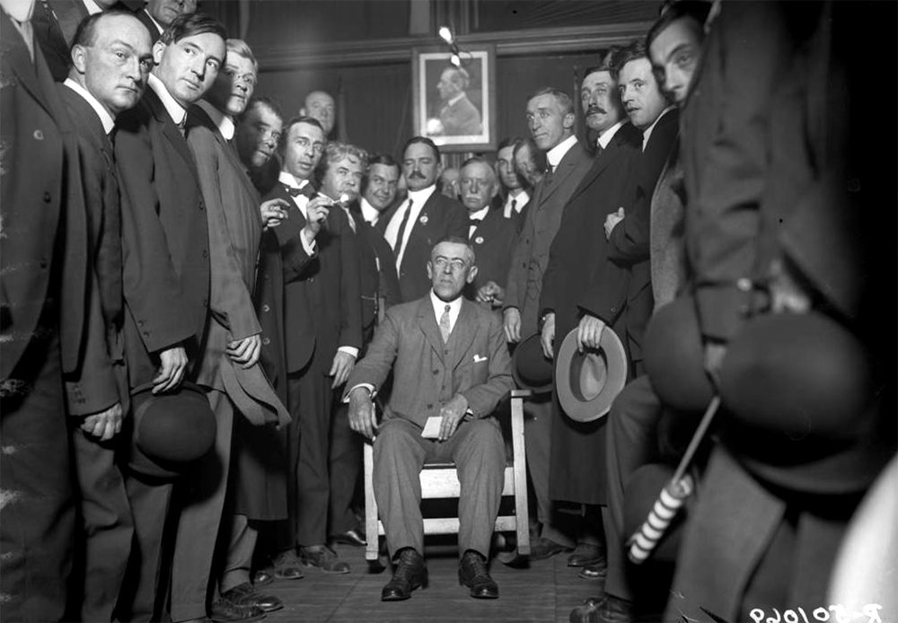 President Woodrow Wilson sits surrounded by a group of men at the Denver Press Club, Denver, Colorado. Between 1910 and 1930. (Harry Mellon Rhoads/Denver Public Library/Western History Collection/Rh-651)  historic; denver public library; dpl; archive; archival; denverite