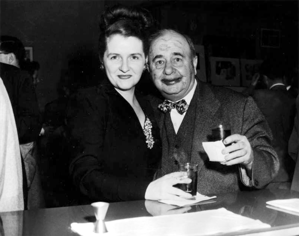 Mary Coyle Chase and Harry Rhoads at a Denver Press Club event, in Denver, Colorado. Mr. Rhoads has lipstick marks on his face. Between 1940 and 1950. (Harry Mellon Rhoads/Denver Public Library/Western History Collection/Rh-5941)  historic; denver public library; dpl; archive; archival; denverite