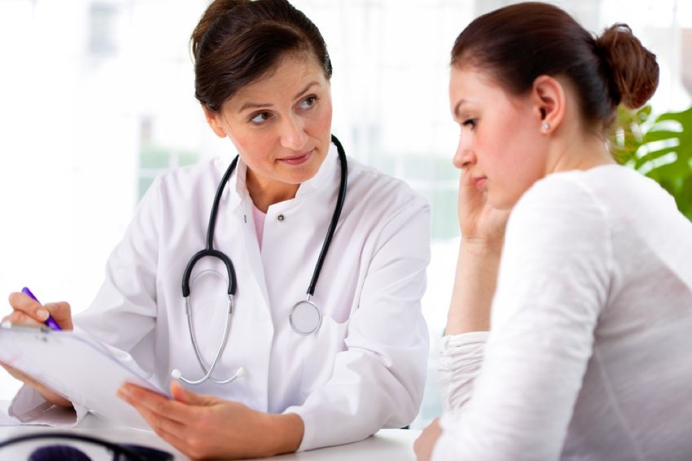 A stock photo of a doctor talking to a patient. (Ilmicrofono Oggiono/Flickr)