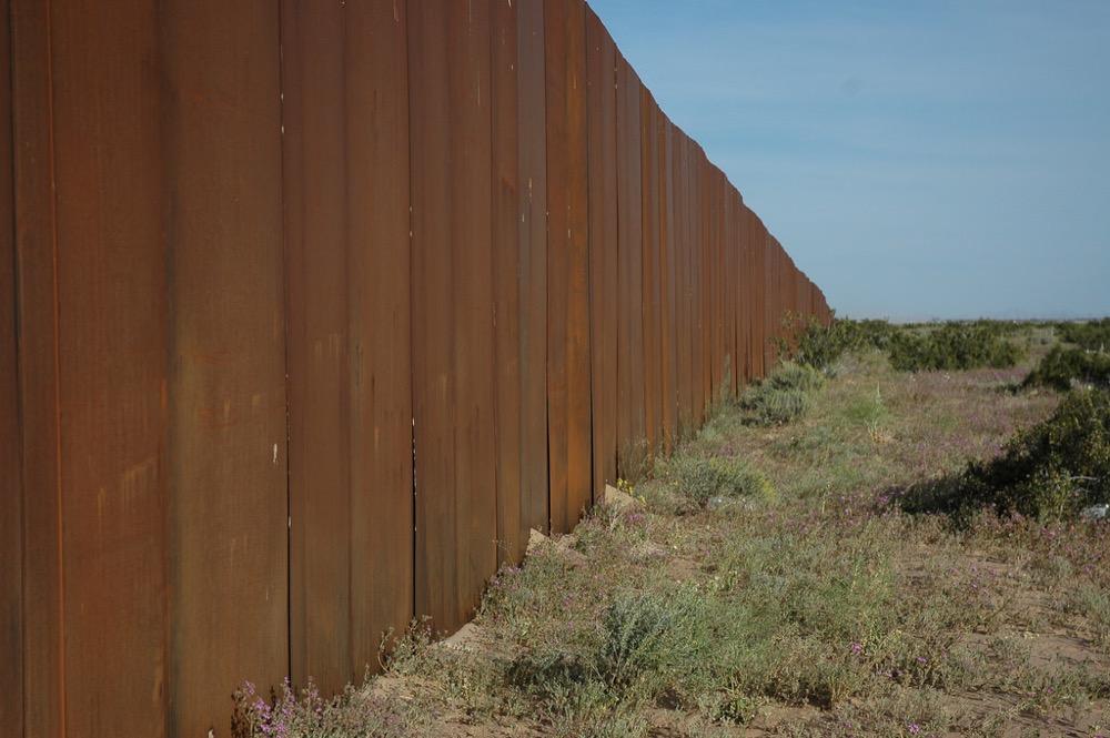 The U.S.-Mexico border wall in the Sonora Desert. (Wonderlane/Flickr)