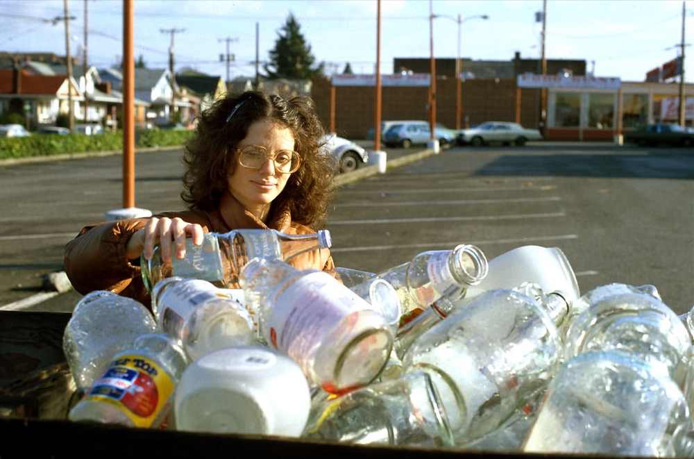 A woman recycles in Seattle, circa 1985. (Seattle Municipal Archives/Flickr)